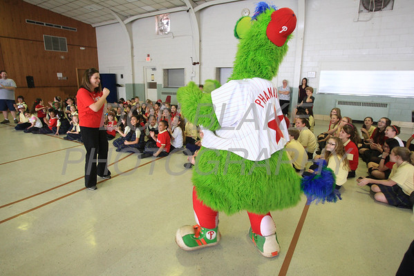 The Phillie Phanatic dances with 3nd grade teacher Rebecca Waldron at Our Lady of Fatima School, Friday, March 23, 2012. photo/ www.DonBlakePhotography.com