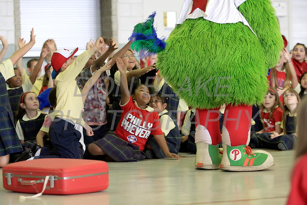 The Phillie Phanatic looks around the room as students raise their hands at Our Lady of Fatima School, Friday, March 23, 2012. photo/ www.DonBlakePhotography.com