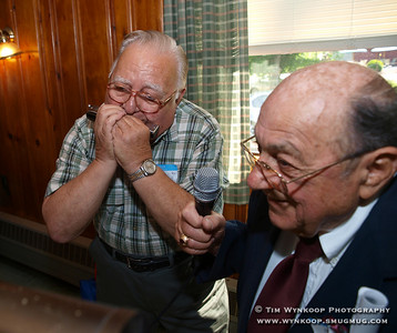 Phillipsburg, NJ, 5/30/2008: Reno Minardi, right, of Alpha, holds the microphone for Warren Graziosi, of Phillipsburg, as he entertains fellow classmates with a few songs on his harmonica at the 65th Phillipsburg High School Class of 1943 reunion at Flynn's on the Hill in Phillipsburg Friday. (Photo by: Tim Wynkoop)
