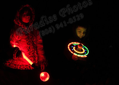 Sorry, I forgot their names.  Please email their names to me at ParadisePhotos808@gmail.com      ? Cayden & brother lights 2137