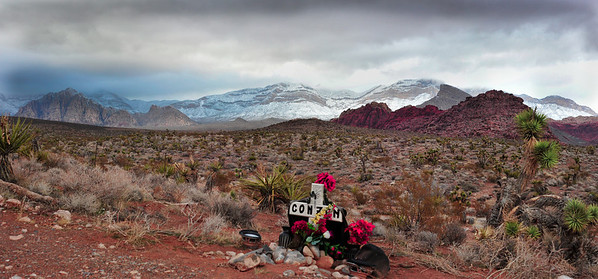 Pictured here is the roadside grave of Conzen, died apparently in a car accident at this spot in 2007. Photographs of Red Rock Canyon and mountains after night of snow in Northwest Las Vegas, Nevada. Red Rock Park starts where West Charleston Blvd. ends and becomes highway. The light is interesting, and the mountains are mantled in fog atop their crest of new snow.