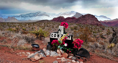 Photographs of Red Rock Canyon and mountains after night of snow in Northwest Las Vegas, Nevada. Red Rock Park starts where West Charleston Blvd. ends and becomes highway. The light is interesting, and the mountains are mantled in fog atop their crest of new snow.
