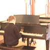 Daniel on he piano, after the performance