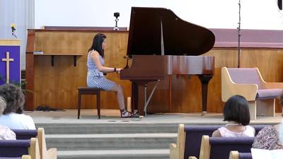 """Sarah performing """"No. 8 La Fille aux cheveux de lin"""""""