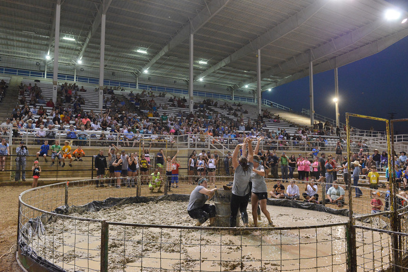 Justin Sheely | The Sheridan Press<br /> Women's division team the Swine Squealers finish for the best time of the night, at 8.57 seconds, during Pig Wrestling at the Sheridan County Fairgrounds Saturday, July 28, 2018.