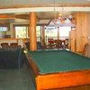 Photo from website<br /> <br /> Rec room with wet bar, pool table, tv, fireplace, game table...