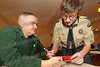 Al Mihalck helps Ryan Mihalck both of Troop 48 add weight to his car