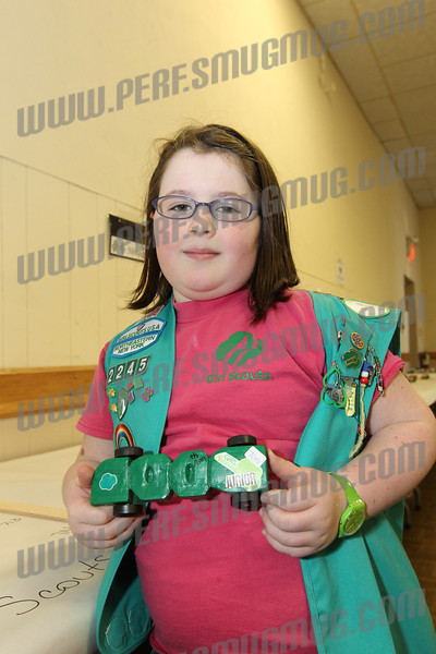 Emily Brittain Girl Scout Troop 2245 displays her 100 year Girl Scout anniversary car before the race