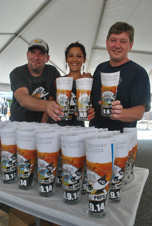 . Joe Hess, Sarah Valentine and Karel Minor from the Humane Society Pennsylvania are ready for Phoenixville\'s first ever Pints for Pups.
