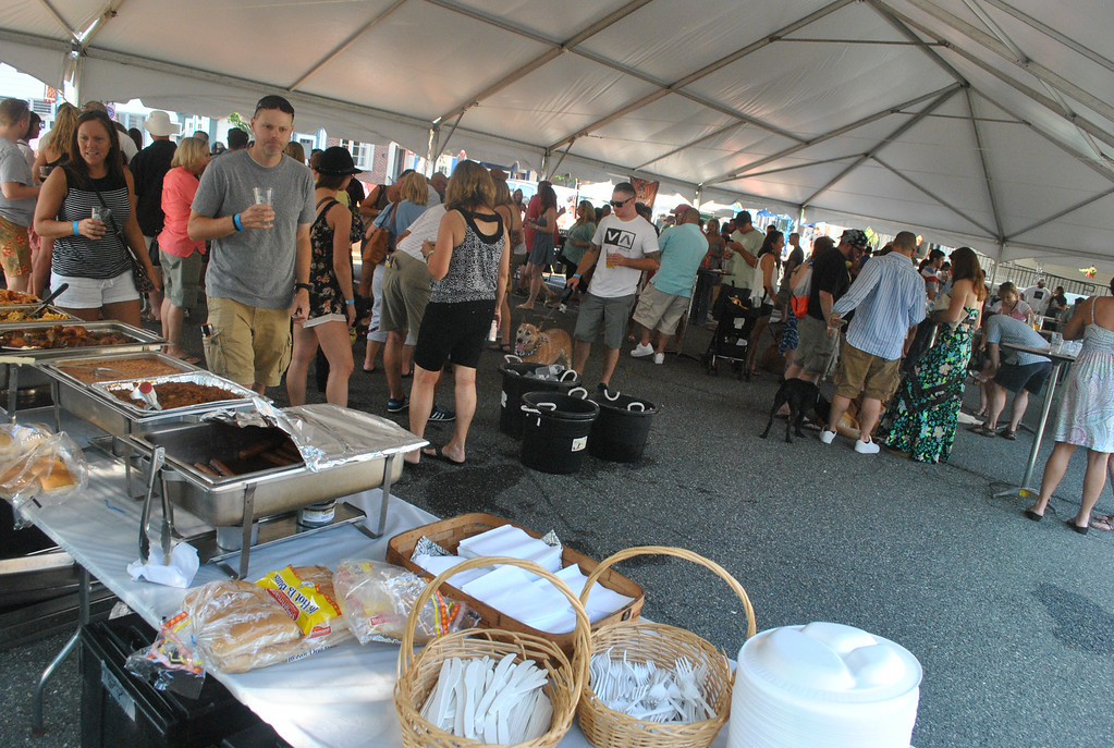 . The crowd at Pints for Pups enjoys the music and samples the beers.