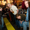 Record-Eagle/Jan-Michael Stump<br /> A crowd lines the track to watch Wednesday night Pintwood Derby races at Right Brain Brewery.