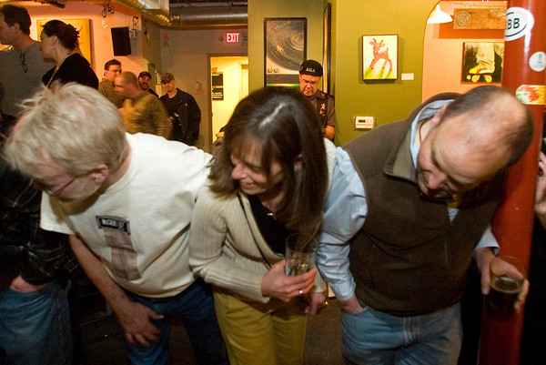 Record-Eagle/Jan-Michael Stump<br /> From left, Bob Brown, Jenny Thomas and Matt Thomas watch the finish of a Wednesday night Pintwood Derby race at Right Brain Brewery.
