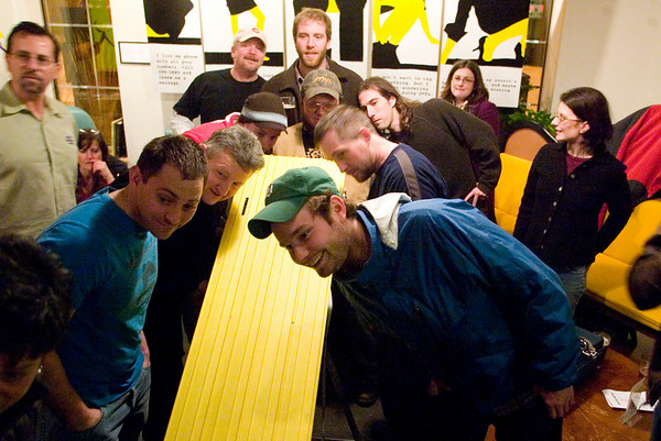 Record-Eagle/Jan-Michael Stump<br /> Competitors watch their cars during a test run before the start of Wednesday night Pintwood Derby races at Right Brain Brewery. Races are organized by brackets, leading to a nightly champion. Points are awarded for the races, as well as aesthetics, towards The Beer Cup series championship.