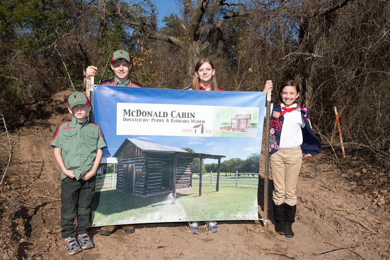 Daniel, Stephen, Jordan and Hannah Russell of Trail Life USA and American Heritage Girls at the planned location of a log cabin in Pioneer Park.