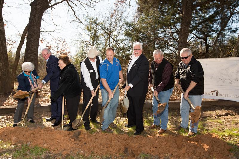 From left: Dorothy Doss, Mayor Dennis Hooks, Ann Saunders, Dean Hungage, Raymond Bowen, Judge Mark Riley, Joe Tison and Frank Martin weilded shovels at the groundbreaking ceremony for Pioneer Park.