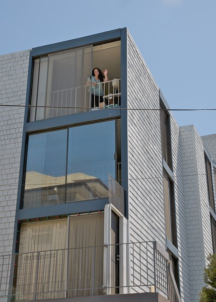 Janet waving from our Oakland apartment