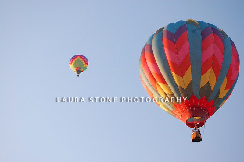Two hot air balloons in the sky on a bright summer morning.