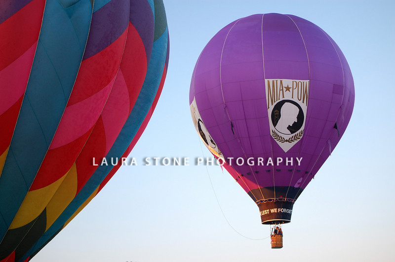 PLAINVILLE, CT: A purple hot air balloon with the POW MIA logo rises into the sky during the annual Plainville Hot Air Balloon Festival on August 29, 2010 in Plainville, Connecticut.