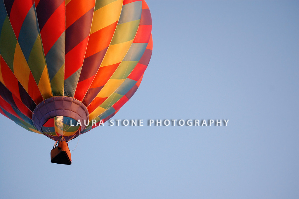 A blast of heated gas keeps a hot air balloon in flight