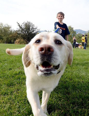 "TJ Rowan, 6, brings his dog, Hera, to Scott Carpenter Park to set a world recond during Play-Dead-A-Palooza.<br />  Bixbi Pet (makers of 100 percent USA sourced dog treats) to set the world recordof 11 dogs playing dead at once. A world record effort, supported by RecordSetter,  is to raise awareness about tainted dog treats.<br /> For more photos and a video of the dogs, got to  <a href=""http://www.dailycamera.com"">http://www.dailycamera.com</a>.<br /> Cliff Grassmick  / September 23, 2012"