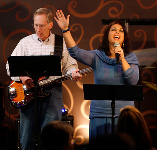 Vocalist Kellie Taylor sings out a melody while bassist Bill Hedges plays his part as they lead worship Sunday morning, December 11, 2011 at Pleasant Valley Community Church in Owensboro, KY.
