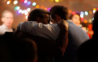 Church member James Taylor, left, embraces Pastor Jamus Edwards Sunday morning, December 11, 2011 at Pleasant Valley Community Church in Owensboro, KY. Taylor later said he had been sick for nearly three months, and was thanking Edwards for praying for his recovery.