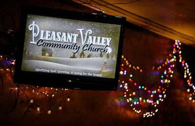 Seasonal lights and video messages decorate the worship space Sunday morning, December 11, 2011 at Pleasant Valley Community Church in Owensboro, KY.