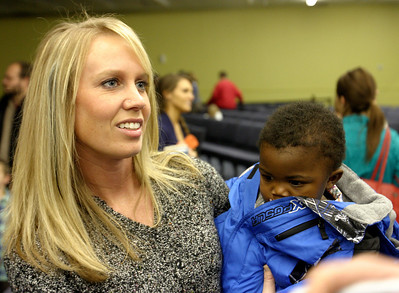 April Stracener, left, with adopted son Utah, 3, Sunday morning, December 11, 2011 at Pleasant Valley Community Church in Owensboro, KY.