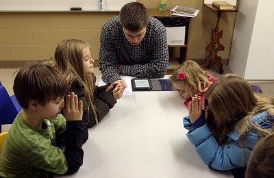 Sunday School teacher Tim Luck leads the first- through third-grade class in prayer Sunday morning, December 11, 2011 at Pleasant Valley Community Church in Owensboro, KY.