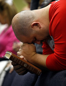 Church member Roger Chilton bows his head during a prayer Sunday morning, December 11, 2011 at Pleasant Valley Community Church in Owensboro, KY.