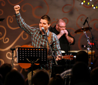 Worship Pastor Brandon Swanner leads the congregation in song Sunday morning, December 11, 2011 at Pleasant Valley Community Church in Owensboro, KY. Pastor Jeremy Hatfield, right, plays a harmonica.