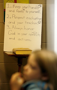 A poster reminding children of proper behavior stands above a Bible Sunday morning, December 11, 2011 at Pleasant Valley Community Church in Owensboro, KY. The poster was in a Sunday School class for first- through third-graders.