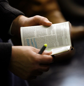 A Bible is read during the adult Sunday School class Sunday morning, December 11, 2011 at Pleasant Valley Community Church in Owensboro, KY.