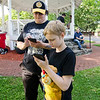 Vicki Tarbell and Kalixtze-Eris Marriner, 11, play Pokemon Go at the Upper Common in Fitchburg on Tuesday evening. SENTINEL & ENTERPRISE / Ashley Green