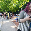Heather Dupont catches Pokemon on the mobile app Pokemon Go at Coggshall Park in Fitchburg on Tuesday afternoon.  SENTINEL & ENTERPRISE / Ashley Green