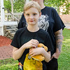 Kalixtze-Eris Marriner, 11, clutches a stuffed Charmander while mom Vicki Tarbell talks about Pokemon at the Upper Common in Fitchburg on Tuesday evening. SENTINEL & ENTERPRISE / Ashley Green