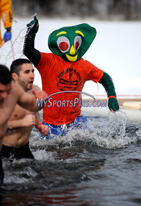 1/22/2010 Mike Orazzi | Staff Brian Patenaude takes the polar plunge at Camp Sloper in Southington on Saturday during the 6th Annual YMCA Polar Plunge.