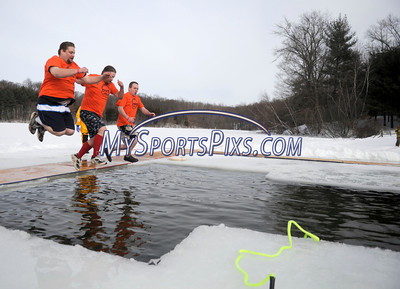1/22/2010 Mike Orazzi | Staff Eric Charette, Kyle Charette and Brian Wellington take the polar plunge at Camp Sloper in Southington on Saturday during the 6th Annual YMCA Polar Plunge.