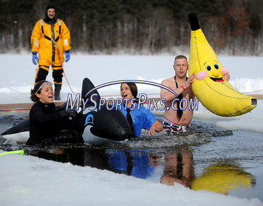 1/22/2010 Mike Orazzi | Staff Lauren Forgione, Alyssa Calvanese and Don Jenkins take the polar plunge at Camp Sloper in Southington on Saturday during the 6th Annual YMCA Polar Plunge.