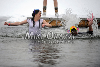 1/21/2012 Mike Orazzi | Staff Alyssa Calvanese and Don Jenkins in ice cold water during the 7th Annual YMCA Polar Plunge at Camp Sloper in Southington on Saturday.