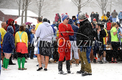 1/21/2012 Mike Orazzi | Staff Jumpers wait for their chance at ice cold water during the 7th Annual YMCA Polar Plunge at Camp Sloper in Southington on Saturday.