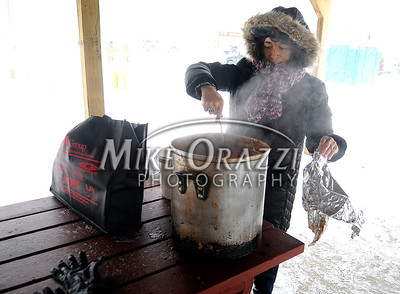 1/21/2012 Mike Orazzi | Staff Karen McCarthy stirs a pot of minestrone soup from the Pepper Pot during the 7th Annual YMCA Polar Plunge at Camp Sloper in Southington on Saturday.