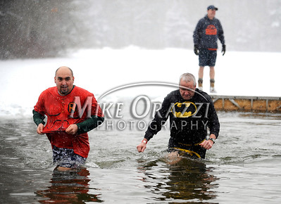 1/21/2012 Mike Orazzi | Staff Robin and Batman in ice cold water during the 7th Annual YMCA Polar Plunge at Camp Sloper in Southington on Saturday.