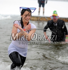 1/21/2012 Mike Orazzi | Staff Alyssa Calvanese runs out of ice cold water during the 7th Annual YMCA Polar Plunge at Camp Sloper in Southington on Saturday.
