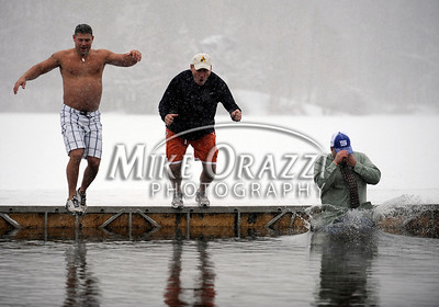 1/21/2012 Mike Orazzi | Staff David Lapreay, Director of the Southington Parks and Recreation, Town Manger Garry Brumback, and Asst. Town Manger Mark Sciota, during the 7th Annual YMCA Polar Plunge at Camp Sloper in Southington on Saturday.