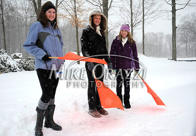 1/21/2012 Mike Orazzi | Staff Parking attendants, left to right: Maisey Ayer, Meghan Condren and Amanda Russman direct traffic during the 7th Annual YMCA Polar Plunge at Camp Sloper in Southington on Saturday.