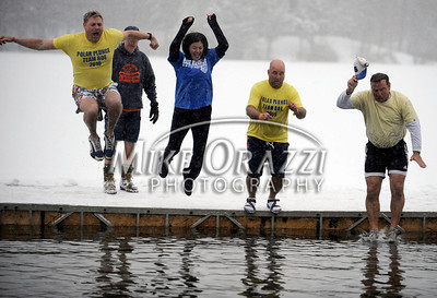 1/21/2012 Mike Orazzi | Staff Jumpers during the 7th Annual YMCA Polar Plunge at Camp Sloper in Southington on Saturday.