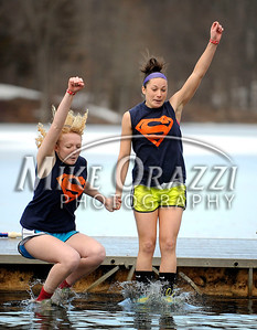 1/19/2013 Mike Orazzi | Staff Kiah DeVona and Maggie Reiss take the plunge during the Annual Camp Sloper Polar Bear Plunge on Saturday in Southington.