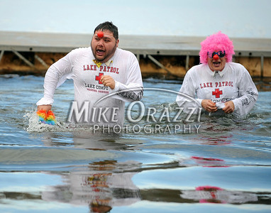 1/19/2013 Mike Orazzi | Staff Members of the Lake Compounce team Michael Cordani and Barbara Parlee take the plunge during the Annual Camp Sloper Polar Bear Plunge on Saturday in Southington.