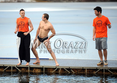 1/19/2013 Mike Orazzi | Staff Jeff Glowa, Robert Palko and Shane Altwies prepare to the plunge during the Annual Camp Sloper Polar Bear Plunge on Saturday in Southington.